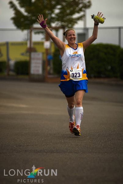 Long Run Pictures took this great one of me at the finish line of the 2013 Every Girl's HM