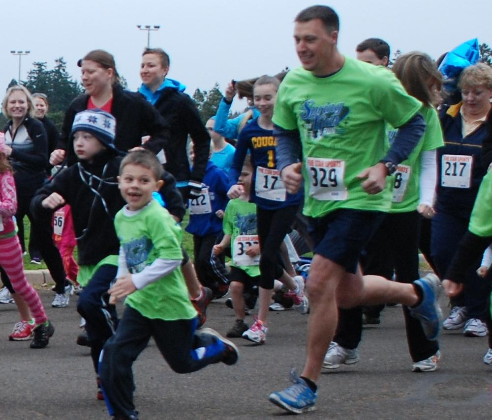 Runners young and old take to the streets for the Spring for Kids runs.