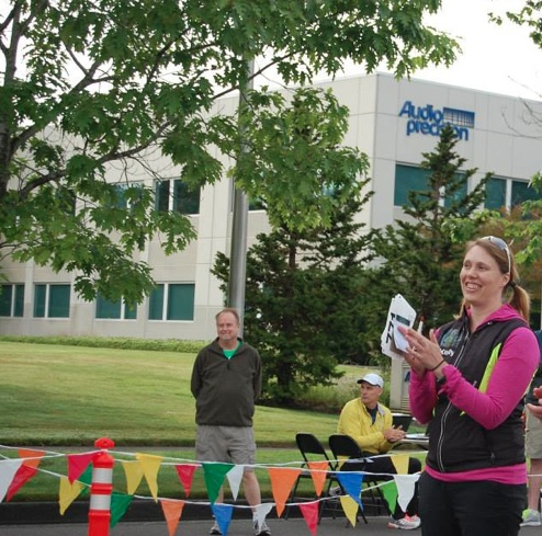 Race Director Kelly Barten makes some last-minute announcements before the start of the Joe Dudman 5.0k Birthday Run (Photo by Annette Vaughn)